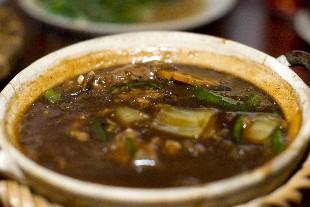 Thit Heo Kho Nuoc Dua (Schweinefleisch gegart in Kokosnusssaft)